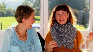 Sisters laughing at favorite family stories